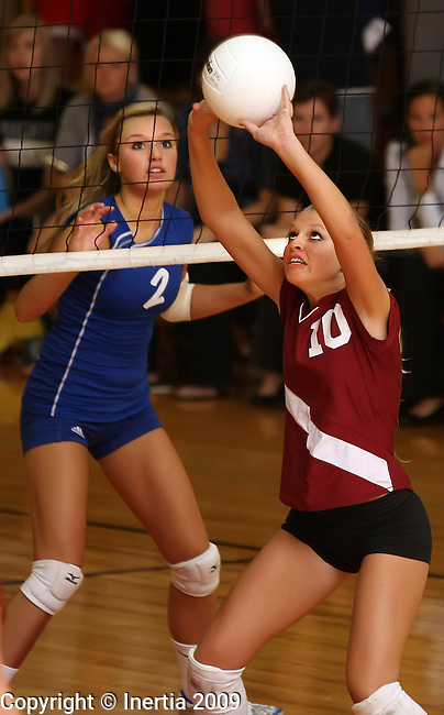 SIOUX FALLS, SD - SEPTEMBER 24: Erica Coomes #10 of Roosevelt sets the ball in front of Rayna Pearson #2 of O'Gorman in the third game of their match Thursday at Roosevelt. (Photo by Dave Eggen/Inertia).