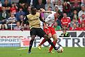 James Dunne of Stevenage is tackled by Moses Odubajo of Leyton Orient<br />  - Stevenage v Leyton Orient - Sky Bet League 1 - Lamex Stadium, Stevenage - 17th August, 2013<br />  © Kevin Coleman 2013