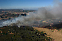Aerial image a forest fire in Los Barrios, near Cadiz on July 25, 2015. Since July 19 wildfires have ravaged nearly 39,000 hectares of land in Spain, according to the provisional figures from the agriculture ministry. © Pedro ARMESTRE