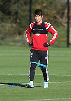 Pictured: Ki SUng Yueng Wednesday 05 November 2014<br /> Re: Swansea City FC players training at Fairwood training ground, ahead of their Premier League game against Arsenal on Sunday.