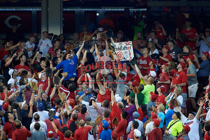 Fans attempt to catch home run baseballs during the MLB Home Run Derby on July 13, 2015 at Great American Ball Park in Cincinnati, Ohio.  (Mike Janes/Four Seam Images)