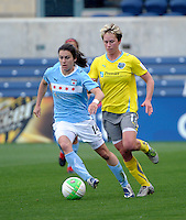 Chicago midfielder Karen Carney (14) dribbles away from Philadelphia midfielder Joanna Lohman (17).  The Philadelphia Independence defeated the Chicago Red Stars 1-0 at Toyota Park in Bridgeview, IL on May 15, 2010.