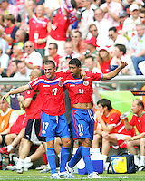 Ronald Gomez (11) of Costa Rica celebrates his goal with Gabriel Badilla (17). Poland defeated Costa Rica 2-1 in their FIFA World Cup Group A match at FIFA World Cup Stadium, Hanover, Germany, June 20, 2006.