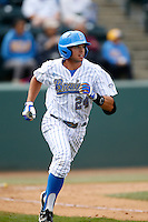 Brian Carroll #24 of the UCLA Bruins runs the bases against the Washington Huskies at Jackie Robinson Stadium on March 17, 2013 in Los Angeles, California. (Larry Goren/Four Seam Images)