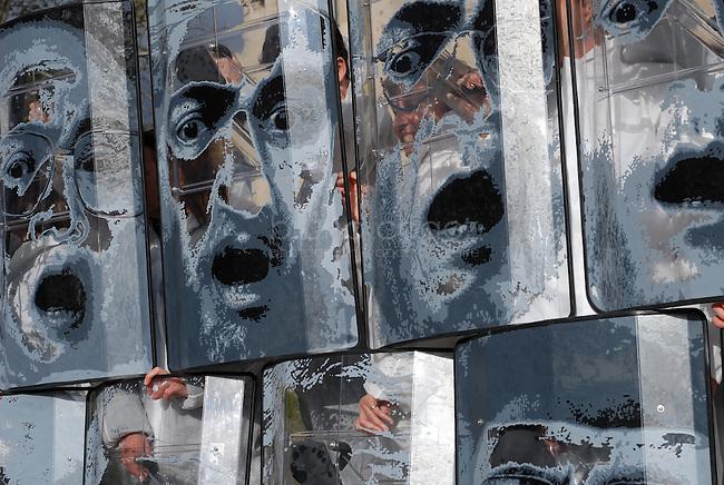 """FRANCE, Paris, 19.10.2011.Persée MMXI,  Laura Todoran, Olivier Peyroux..Cette installation achevée en octobre 2010 est directement inspirée de « Medusa » peinte par Carravagio. Il s'agit d'une déclinaison contemporaine de cette œuvre. A la place de Medusa sont représentés 12 dictateurs ou sanguinaires actuellement en vie. Le bouclier en bois est remplacé par des boucliers antiémeutes. Plus qu'une œuvre politique, cette installation invite à la réflexion, sur l'image, la faiblesse, la mort et le pouvoir. Les portraits reprennent tous l'expression de Meduse quand elle comprend qu'elle est mortelle via son reflet dans le bouclier-miroir utilisé par Persée. A travers l'image renvoyée par les monstres le spectateur se transforme en Persée. Au vu des événements récents, printemps arabe, mort de Ben Laden... ce travail prend une dimension prémonitoire. .Perseus MMXI, Laura Todoran, Olivier Peyroux..This installation  completed in October 2010 is directly inspired by """"Medusa,"""" painted by Carravagio. This is a contemporary variation of this work. Instead of Medusa represented 12 or bloodthirsty dictators alive today. The wooden shield is replaced with riot shields. More than a political work, this installation invites reflection on the image, weakness, death and power. Include all the portraits express Medusa when she realizes she is deadly through its reflection in the mirror shield used by Perseus. Through the image returned by the monsters the viewer becomes Perseus. In light of recent events, Arab spring, death of Bin Laden ... this work takes on a premonition...© Bruno Cogez"""