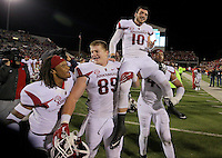 11/7/15<br /> Arkansas Democrat-Gazette/STEPHEN B. THORNTON<br /> Arkansas teammeber carry their QB Brandon Allen off the field after  winning the game on Allen's two point conversion in overtime to beat  Ole Miss  Saturday's game in Oxford, Miss.