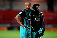 Andre Ayew and Nathan Dyer of Swansea City look dejected at full time during the Sky Bet Championship Play Off Semi-final 2nd Leg between Brentford and Swansea City at Griffin Park in Brentford, England, UK. 29th July, 2020