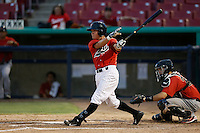 Patrick Brady #22 of the High Desert Mavericks bats against the Visalia Rawhide at Stater Bros. Stadium on July 20, 2013 in Adelanto, California. High Desert defeated Visalia, 7-4. (Larry Goren/Four Seam Images)