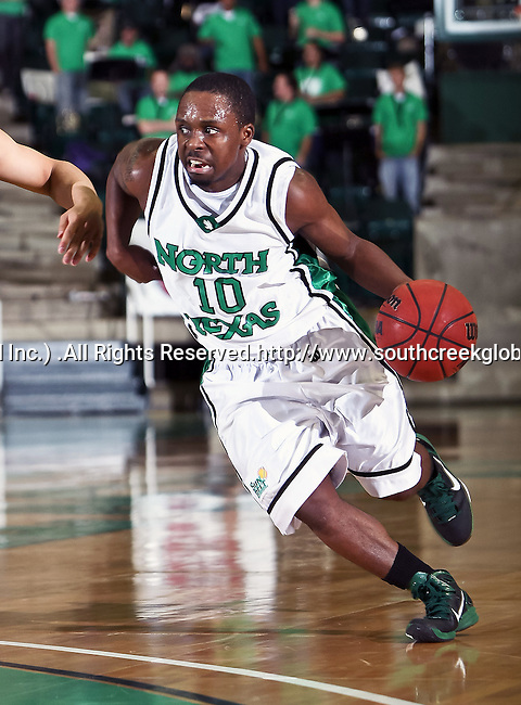 North Texas Mean Green guard Josh White (10) drives the ball toward the basket in the game between the Texas State Bobcats and the University of North Texas Mean Green at the North Texas Coliseum,the Super Pit, in Denton, Texas. UNT defeated Texas State 85 to 62