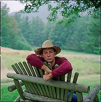 Man wearing straw hat looking at camera<br />
