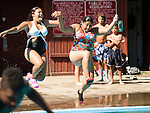 WATERBURY, CT- 3 August 2015-080315EC01-  Gianna Algarin and Waleska Castillo jump into the pool while having fun at Fulton Park in Waterbury Monday afternoon. The city pool was packed as temperatures climbed toward 90 degrees. The pool closes for the season next week. Erin Covey Republican-American