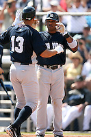 February 25, 2009:  Second baseman Robinson Cano (24) of the New York Yankees congratulates Alex Rodriguez (13) after hitting a home run during a Spring Training game at Dunedin Stadium in Dunedin, FL.  The New York Yankees defeated the Toronto Blue Jays 6-1.   Photo by:  Mike Janes/Four Seam Images