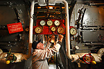 Pictured:  Volunteer Graham Martin, Chief Engineer, performs maintenance in the boiler room of Southampton's Steamship Shieldhall as the team put Shieldhall to bed for the winter.<br /> <br /> The steamship marked her 65th birthday this summer, but was unable to celebrate as planned due to the pandemic. However, behind-the-scenes work on Shieldhall means that Southampton's heritage steamship is in excellent condition, with volunteers looking forward to a full 2021 sailing programme. <br /> <br /> Shieldhall last sailed in September 2019, and plans to sail again with passengers on board in May 2021. <br /> <br /> The ship provides a working example of steamship machinery both above and below deck, typical of the cargo and passenger ships that plied the oceans of the world from the 1870s until the mid 1960s, by which time they were all but extinct.<br /> <br /> Special trips held over from 2020 will be staged next year, including a cruise to celebrate the 200th anniversary of the first steamship to leave Southampton, the Prince of Cobourg, in 1820. <br /> <br /> Initially, a limited number of tickets will be available as Shieldhall introduces COVID-compliant measures on board during the autumn and winter. A Government Heritage Emergency Grant awarded during the summer has assisted Shieldhall's volunteers in carrying out essential maintenance works on the ship. <br /> <br /> © Simon Czapp/Solent News & Photo Agency<br /> UK +44 (0) 2380 458800