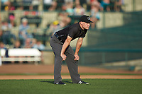 Umpire Bobby Tassone handles the calls on the bases during the Midwest League game between the West Michigan Whitecaps and the Fort Wayne TinCaps at Parkview Field on August 5, 2019 in Fort Wayne, Indiana. The TinCaps defeated the Whitecaps 9-3. (Brian Westerholt/Four Seam Images)