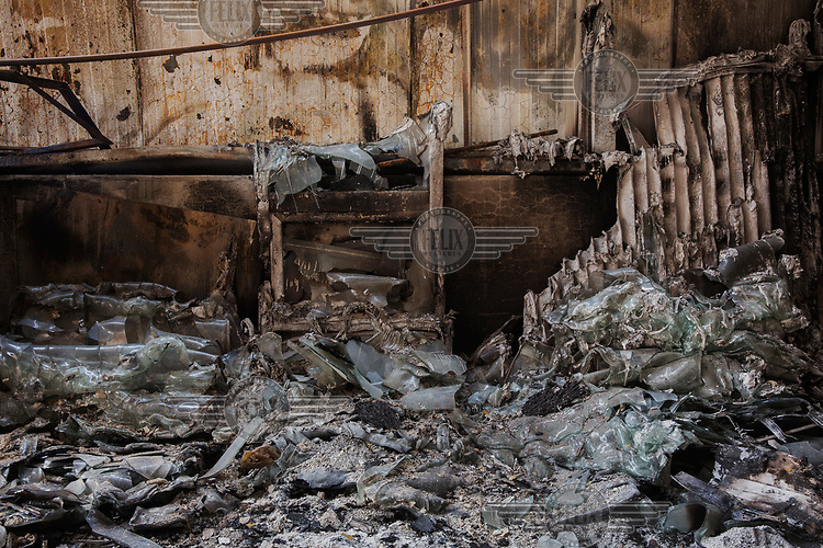 Glass melted by the heat of a fire that destroyed a construction company in Oliveira do Hospital. In that year, 115 people lost their lives and at least 5,000 km² (roughly 2,000 square miles) of Portuguese territory was destroyed by forest fires.