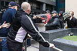 """© Joel Goodman - 07973 332324 . 11/06/2017 . Manchester , UK . Far right supporters spray pepper spray at anti fascist demonstrators . Demonstration against Islamic hate , organised by former EDL leader Tommy Robinson's """" UK Against Hate """" and opposed by a counter demonstration of anti-fascist groups . UK Against Hate say their silent march from Piccadilly Train Station to a rally in Piccadilly Gardens in central Manchester is in response to a terrorist attack at an Ariana Grande concert in Manchester , and is on the anniversary of the gun massacre at the Pulse nightclub in Orlando . Photo credit : Joel Goodman"""