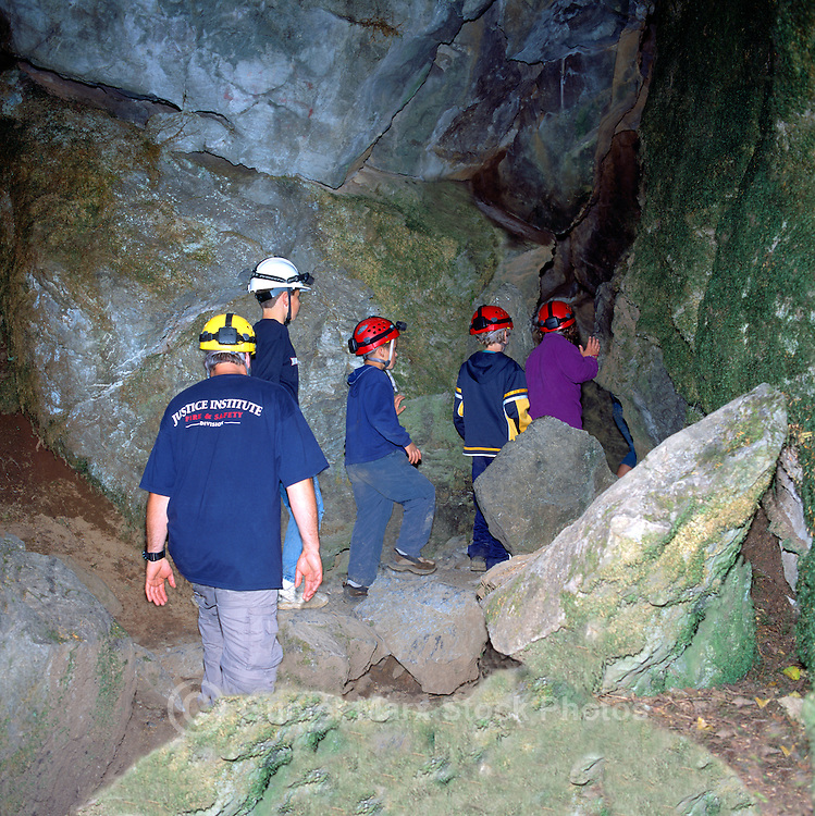 Tourist Spelunkers, on Guided Tour, explore Riverbend Cave at Horne Lake Caves Provincial Park, on Vancouver Island, British Columbia, Canada