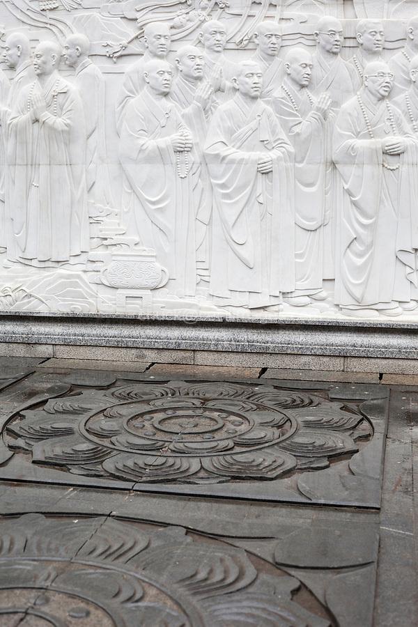 Nanjing, Jiangsu, China.  Niushou Mountain Buddhist Ashram.  Wall Mural Depicting Monks, Lotus Floor Decoration.