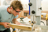 Using a bandsaw to prepare a window frame.  Able Skills in Dartford, Kent, runs courses in construction industry skills like, bricklaying, carpentry and tiling.