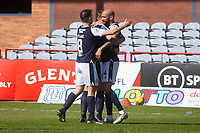 24th April 2021; Dens Park, Dundee, Scotland; Scottish Championship Football, Dundee FC versus Raith Rovers; Liam Fontaine of Dundee is congratulated after scoring for 2-0 by Lee Ashcroft and Shaun Byrne