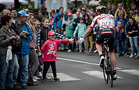 Tom Bohli (SUI/UAE-Emirates) making this kid 'the happiest one in town' at the race start in Ivrea<br /> <br /> Stage 15: Ivrea to Como (232km)<br /> 102nd Giro d'Italia 2019<br /> <br /> ©kramon