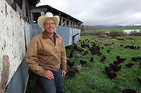 Farmer Joel Salatin poses in a front of his mobile chicken coup he invented allowing his chickens to graze in a new field each morning October 20, 2006 at the Polyface Farm in Staunton, Va.  ...Photo by Andrew B. Shurtleff, Freelance. farmer