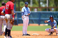 FCL Rays manager Rafael Valenzuela (10) and Shane Sasaki (37) question a call at second base during a game against the FCL Twins on July 20, 2021 at Charlotte Sports Park in Port Charlotte, Florida.  (Mike Janes/Four Seam Images)