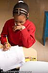 K-8 Parochial School Bronx New York Grade 1 language arts female student at work on multiple choice worksheet vertical