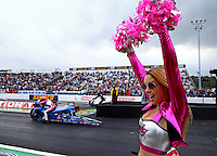 Oct 3, 2014; Mohnton, PA, USA; A cheerleader reacts as NHRA pro stock motorcycle rider Angie Smith prepares to race during qualifying for the NHRA Nationals at Maple Grove Raceway. Mandatory Credit: Mark J. Rebilas-USA TODAY Sports