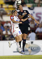 Abby Wamhach of USA heads the ball.. USWNT defeated Costa Rica 4-0 in the 2010 CONCACAF Women's World Cup Qualifying tournament held at Estadio Quintana Roo in Cancun, Mexico on November 1st, 2010.