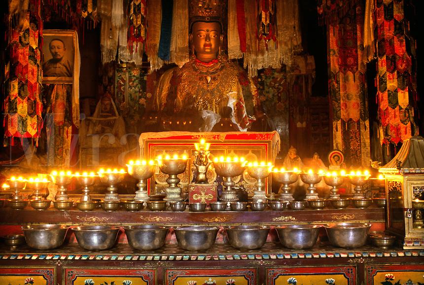 BUTTER LAMPS & SHAKYAMUNI STATUE inside the main temple at SAMYE MONASTERY known as SAMYE UTSE - TIBET