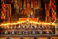 BUTTER LAMPS & SHAKYAMUNI STATUE inside the main temple at SAMYE MONASTERY known as SAMYE UTSE - TIBET