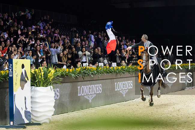 Patrice Delaveau of France riding Aquila HDC celebrates winning the Longines Grand Prix during the Longines Masters of Hong Kong at AsiaWorld-Expo on 11 February 2018, in Hong Kong, Hong Kong. Photo by Diego Gonzalez / Power Sport Images