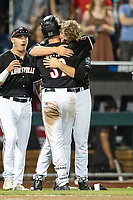 Louisville Cardinals pitcher Michael McAvene (41) hugs teammate Henry Davis (32) after Game 12 of the NCAA College World Series against the Vanderbilt Commodores on June 21, 2019 at TD Ameritrade Park in Omaha, Nebraska. Vanderbilt defeated Louisville 3-2. (Andrew Woolley/Four Seam Images)