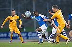 St Johnstone v Motherwell...03.11.12      SPL.Gregory Tade and Simon Ramsden.Picture by Graeme Hart..Copyright Perthshire Picture Agency.Tel: 01738 623350  Mobile: 07990 594431