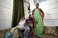 """Djibouti. Djibouti province. Djibouti. Association """"Afisn"""" where street workers, all commercial sex workers (CSW) meet weekly and talk about the HIV Aids disease. Group of black muslim women. The Global Fund through the djiboutian Ministry of Health supports the condoms distribution with an Aids grant (financial aid).  © 2006 Didier Ruef"""