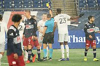 FOXBOROUGH, MA - NOVEMBER 1: Referee David Gantar issues a yellow card to Russell Canouse #4 of DC United during a game between D.C. United and New England Revolution at Gillette Stadium on November 1, 2020 in Foxborough, Massachusetts.