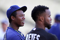 Hanley Ramirez #13 of the Los Angeles Dodgers visits with former teammate Jose Reyes #7 of the Miami Marlins before a game at Dodger Stadium on August 24, 2012 in Los Angeles, California. Los Angeles defeated Miami 11-4. (Larry Goren/Four Seam Images)