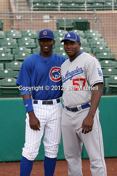 Two native Cubans (Jorge Soler of the AZL Cubs and Yasiel Puig of the AZL Dodgers) meet before a game at Hohokam Stadium on August 8, 2012 in Mesa, Arizona (Bill Mitchell)