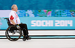 Sochi, RUSSIA - Mar 15 2014 - Jim Armstrong wheels down the ice as Canada takes on Russia in the Gold Medal Wheechair Curling match at the 2014 Paralympic Winter Games in Sochi, Russia.  (Photo: Matthew Murnaghan/Canadian Paralympic Committee)