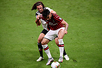 Adrien Rabiot of Juventus and Lucas Paqueta of AC Milan compete for the ball during the Serie A football match between AC Milan and Juventus FC at stadio San Siro in Milan ( Italy ), July 7th, 2020. Play resumes behind closed doors following the outbreak of the coronavirus disease. <br /> Photo Federico Tardito / Insidefoto