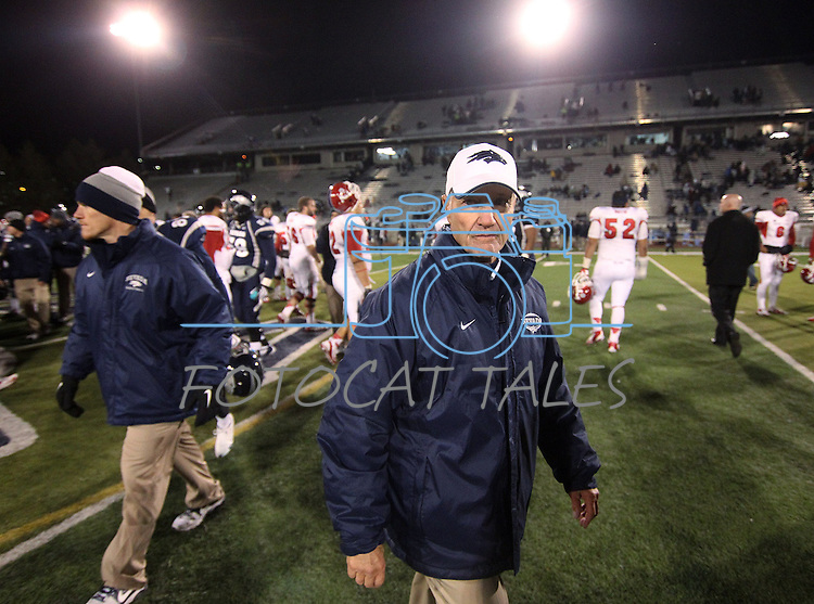 Nevada Head Coach Chris Ault walks off the field after losing to Fresno State 36-52 after an NCAA college football game in Reno, Nev., on Saturday, Nov. 10, 2012. (AP Photo/Cathleen Allison)