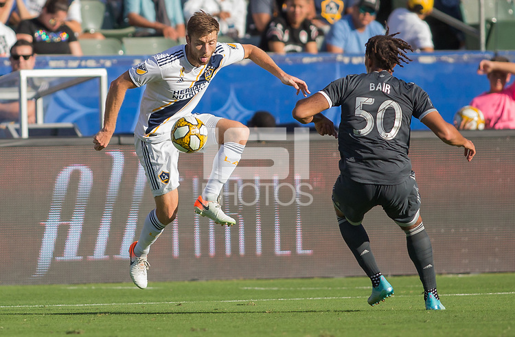 CARSON, CA - SEPTEMBER 29: Dave Romney #4 of the Los Angeles Galaxy traps a ball during a game between Vancouver Whitecaps and Los Angeles Galaxy at Dignity Health Sports Park on September 29, 2019 in Carson, California.