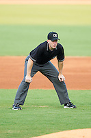 Umpire Chase Eade handles the calls on the bases during the Carolina League game between the Frederick Keys and the Winston-Salem Dash at BB&T Ballpark on July 29, 2014 in Winston-Salem, North Carolina.  The Dash defeated the Keys 4-0.   (Brian Westerholt/Four Seam Images)
