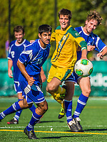28 September 2013: Hartwick College Hawk Midfielder Rio Dhat, a Junior from Auckland, New Zealand, keeps his eye on the ball during game action against the University of Vermont Catamounts at Virtue Field in Burlington, Vermont. The Catamounts shut out the visiting Hawks 1-0. Mandatory Credit: Ed Wolfstein Photo *** RAW (NEF) Image File Available ***