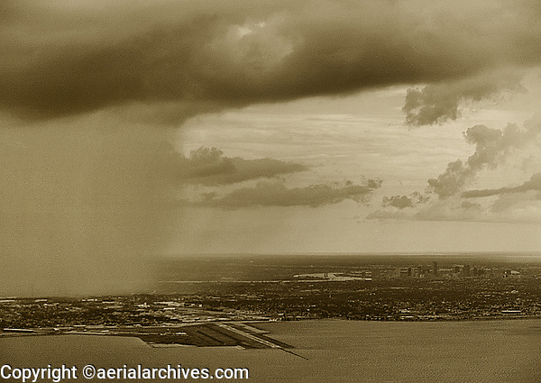 aerial photograph of a rain downpour near the New Orleans Lakefront Airport (NEW), New Orleans, Louisiana