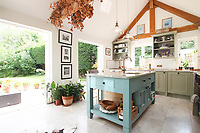 BNPS.co.uk (01202 558833)<br /> Pic: Cheffins/BNPS<br /> <br /> Pictured:  The kitchen has been extended and modernised <br /> <br /> Crime history fans can live in the home of notorious highwayman Dick Turpin for £1,950 a month.<br /> <br /> The infamous criminal ran a butcher's shop from this pretty thatched cottage before he joined a deer thief gang in the 1730s.<br /> <br /> Turpin was born opposite this house at the Bluebell Inn and staged cockfights in a grass area opposite the house which is still known as Turpin's ring.<br /> <br /> Robert Palmer bought the Grade II Listed Dick Turpin's Cottage in Hempstead, Essex, in 2012 and spent eight years gutting and refurbishing the house to make it more suitable for modern living.