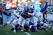 Buffalo Bills running back Chris Ivory (33) is tackled by Neville Hewitt (46) during an NFL football game against the New York Jets, Sunday, December 9, 2018, in Orchard Park, N.Y.  (Mike Janes Photography)