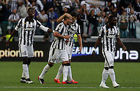 Calcio, Serie A: Juventus vs Napoli. Torino, Juventus Stadium, 23 maggio 2015. <br /> Juventus' Stefano Sturaro, second from left, celebrates with teammates after scoring during the Italian Serie A football match between Juventus and Napoli at Turin's Juventus Stadium, 23 May 2015.<br /> UPDATE IMAGES PRESS/Isabella Bonotto
