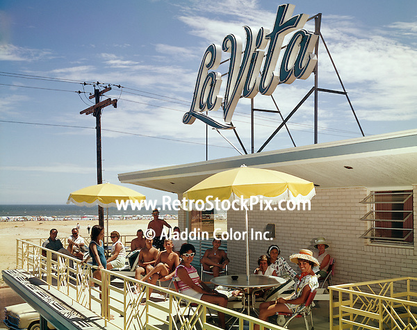 People relaxing on the La Vita Motel in Wildwood New Jersey sundeck.